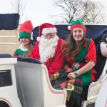 Santa and his elves arriving at the party