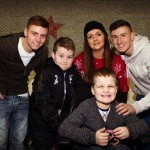 Nathan and his family with the footballers form Rangers